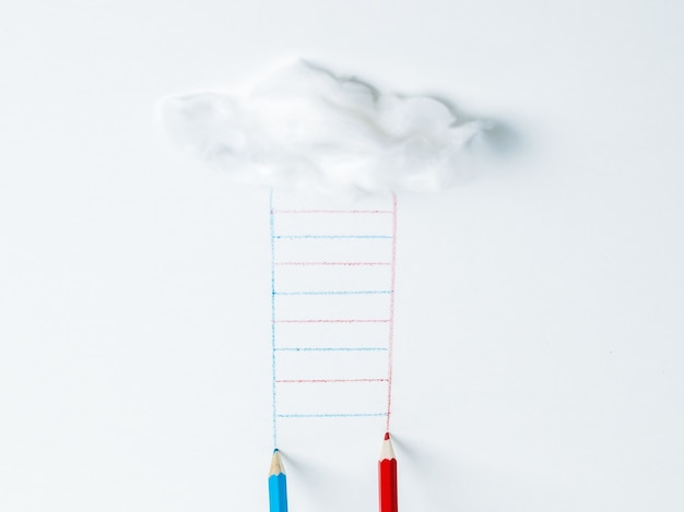 Blue and red pencils drawing a ladder from a cloud. the concept of development.