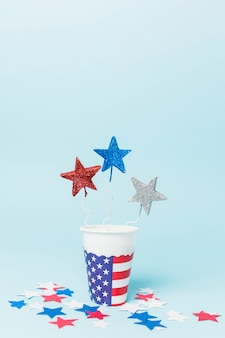 Blue; red and sliver star props in the usa disposable cup with stars on blue backdrop