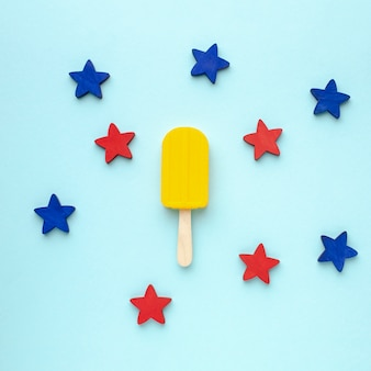 Blue and red stars beside ice cream on stick