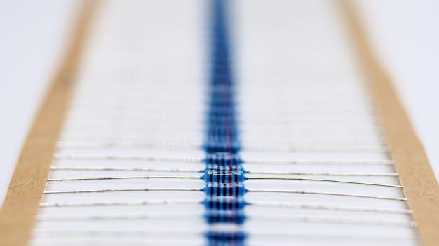 Blue resistor in rowresistor on white background