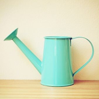Blue retro watering can with filter effect