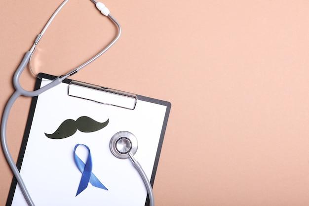Голубая лента на цветном фоне вид сверху мужской рак мужское здоровье