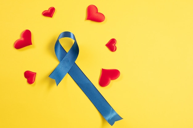 Blue ribbon symbolic of prostate cancer awareness campaign and men's health in november
