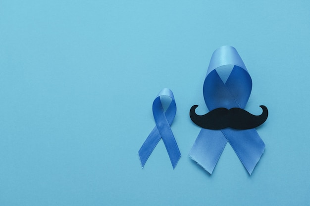 Blue ribbons with mustache, prostate cancer awareness