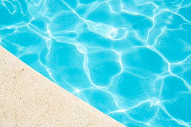 Blue ripped water in swimming pool summer vacation