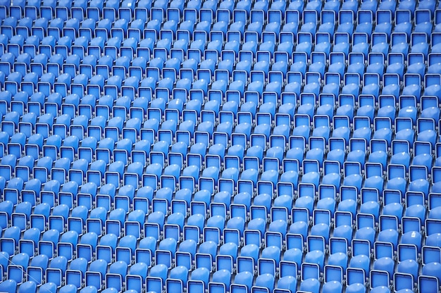 Blue rows of seats on the stadium background