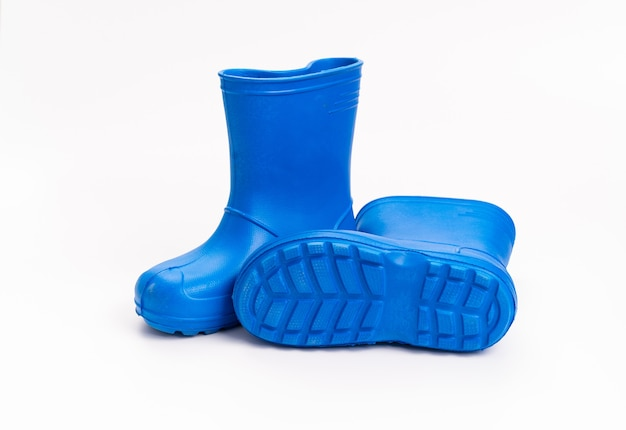 Blue rubber boots on a white background. shoes for rainy weather and puddles. shoe store. protect your feet from dampness and dirt.