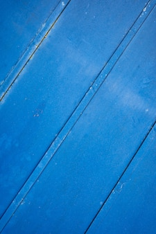 Blue rusty grunge metal background or texture with scratches and cracks