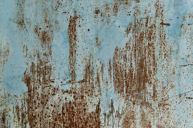 青いさびた金属の質感の背景、クローズアップ。