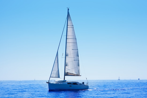Blue sailboat sailing mediterranean sea