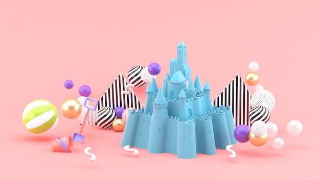 ピンクのカラフルなボールに囲まれた青い砂の城。 3dレンダリング。