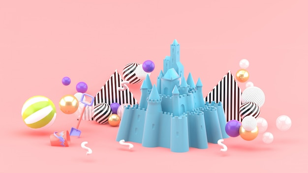 Blue sand castle amidst colorful balls on pink. 3d rendering.