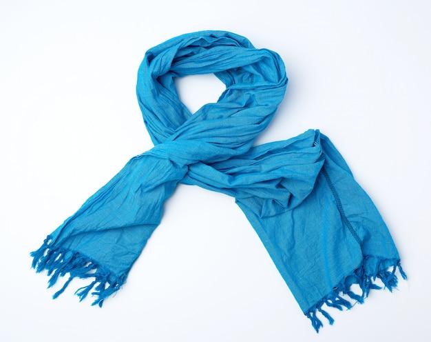 Blue scarf imitates on white surface