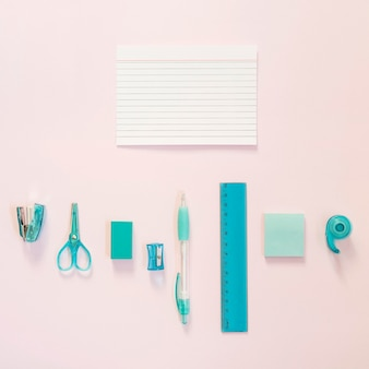 Blue school supplies with notes and copy space
