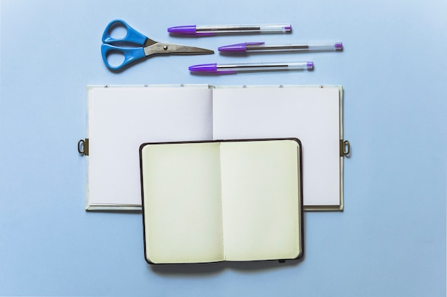 Blue scissors and notebooks