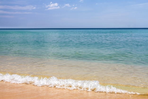 Blue sea sky and waves soft surface of blue ocean on sandy beach summer day, , phuket, thailand