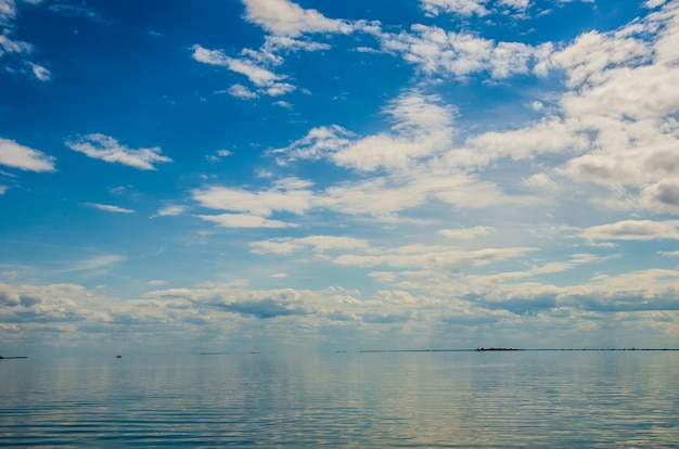 Blue sea and sunny sky with clouds