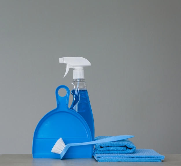 Blue set of cleaning tools and product
