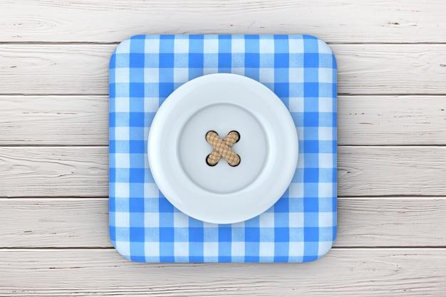 Синяя швейная пуговица над значком синей клетчатой ткани на деревянном столе. 3d рендеринг