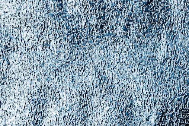 青い光沢のあるテクスチャ紙の背景