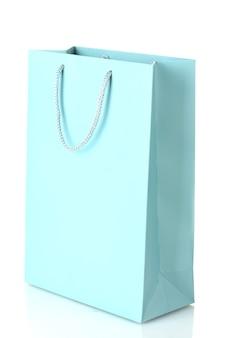 白で隔離の青い買い物袋