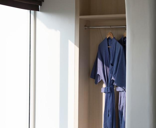 Blue shower dress hang on wardrobe