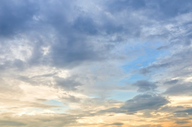 Blue sky background texture with white clouds sunset
