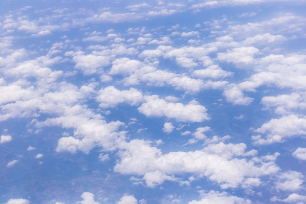 Blue sky background with tiny clouds for graphic design or website template.