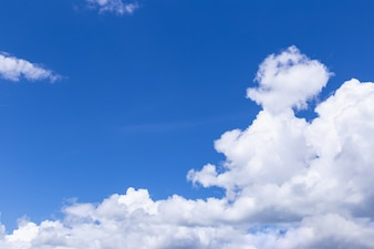 Blue sky background with white clouds, rain clouds on sunny summer or spring day