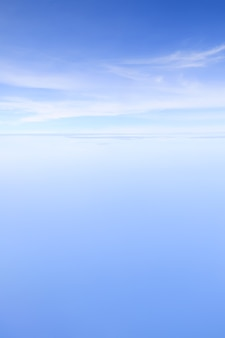 Blue sky and clounds taken from airplane window about 25000 feet high from ground