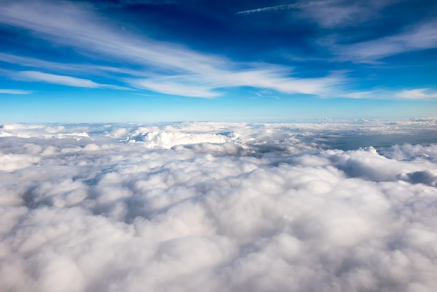 Blue sky above a layer of white clouds