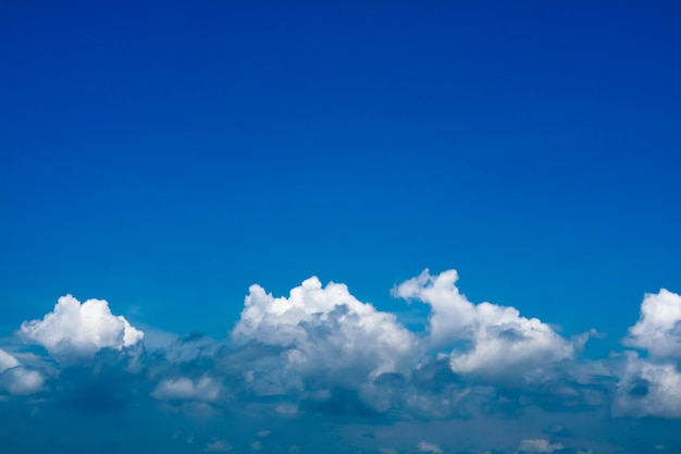 Blue sky and line of heap cloud and clear sky