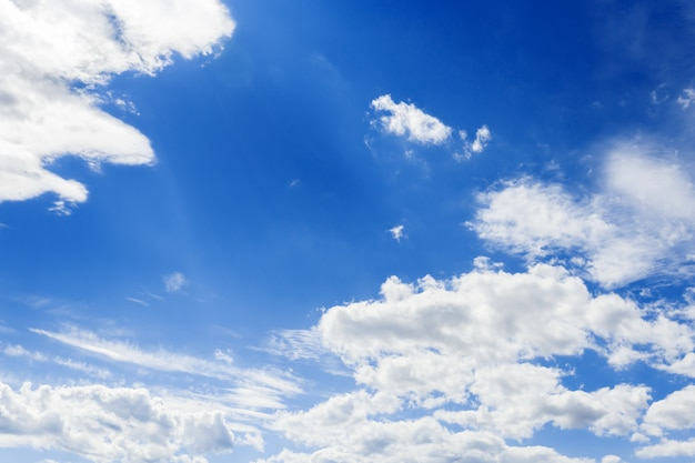 Blue sky surface with tiny clouds