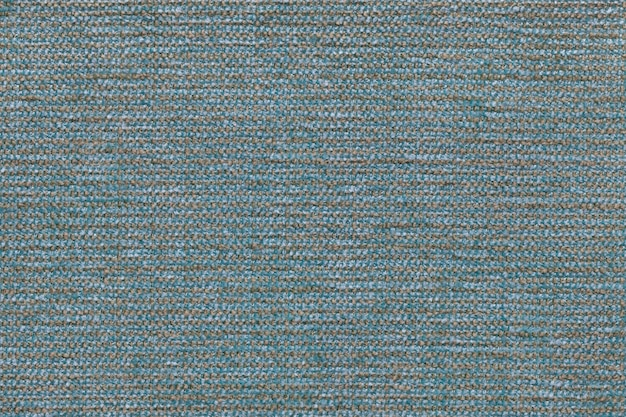 Blue sky textile background with checkered pattern, closeup. structure of the fabric macro.