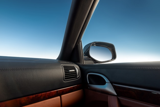 Blue sky viewed from inside a car