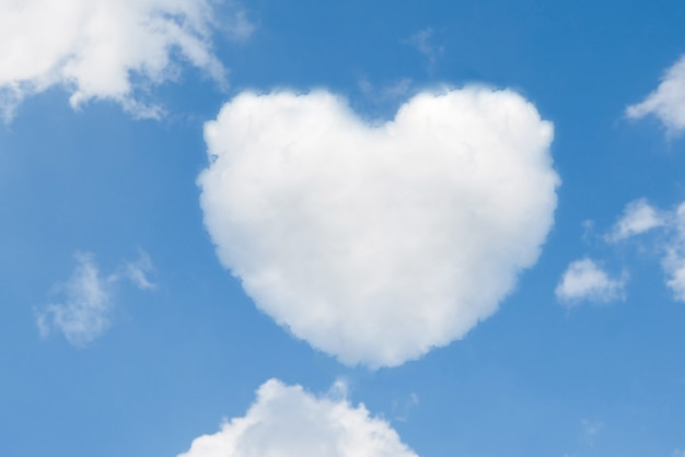 Blue sky with hearts shape clouds. valentine's holiday.