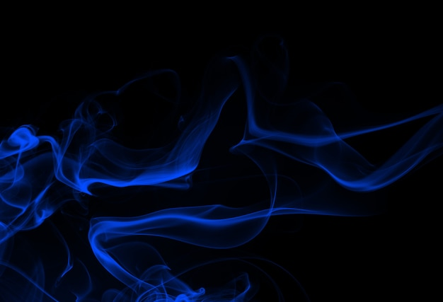 Blue smoke abstract on black background, darkness concept