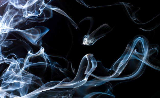 Blue smoke abstract on black background for design. darkness concept
