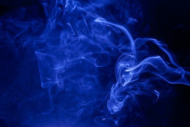 Blue smoke on a black background