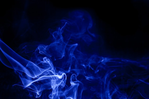Blue smoke on a black background.