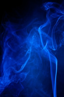 Blue smoke motion on black background.