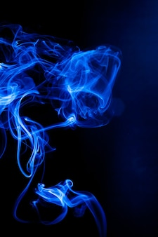 Blue smoke motion on black background. Premium Photo