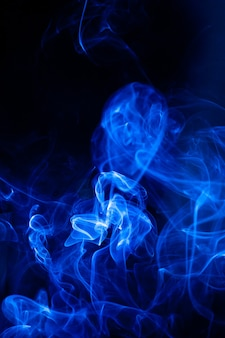 Blue smoke motion on black surface.