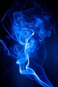 Blue smoke motion on black.