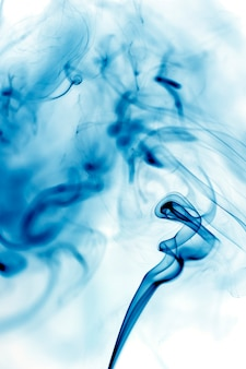 Blue smoke movement on white background.
