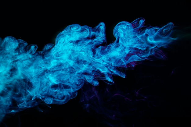 Blue smoke waves on black background