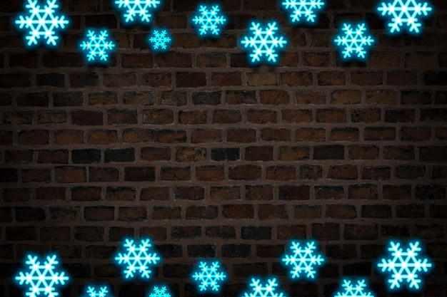 Blue snowflakes, neon sign on the background of the fire wall. concept of snowfall, new year holidays and christmas, winter.