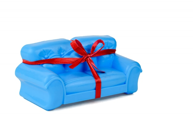 Blue sofa tied with ribbon isolated on white