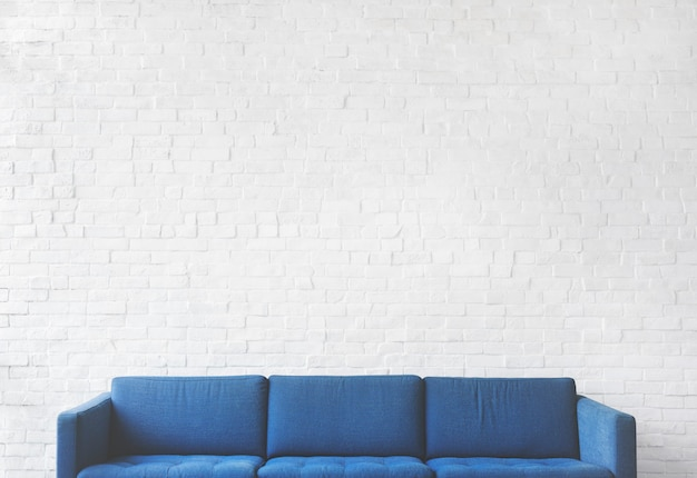 Blue sofa with white brick wall background