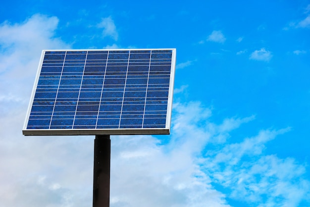 Blue solar panel cell with clipping path on blue cloud sky.